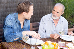 Father and son in garden. Having some food Stock Photo