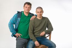 Father and son of gay men. portrait in studio on white. Father and son of gay men. portrait in studio on white royalty free stock images