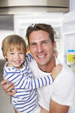 Father And Son Getting Snack From The Fridge Royalty Free Stock Image