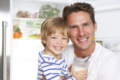 Father And Son Getting Snack From The Fridge Stock Image