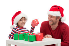 Father and son with gift boxes Stock Photos