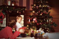 Father and son giving presents on Christmas Stock Image