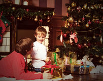 Father and son giving presents on Christmas Stock Images