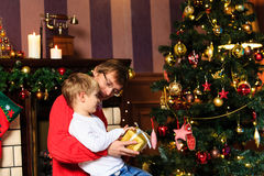 Father and son giving presents in christmas Stock Photos