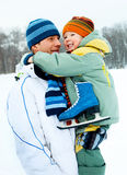 Father and son go ice skating. Happy family, young father going ice skating with his little son Royalty Free Stock Image