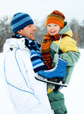 Father and son go ice skating. Happy family, young father going ice skating with his little son Royalty Free Stock Photography