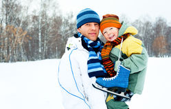 Father and son go ice skating Stock Photo