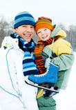 Father and son go ice skating stock image