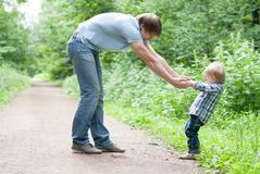 Father and son go in a park. Stock Photos