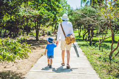 Father and son go on the park path. Royalty Free Stock Photography