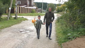 Father and son go on the road with a bouquet stock video