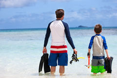 Father and son go snorkeling Stock Images