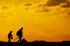 Father and son going fishing. Silhouette of father and son going fishing Stock Photography
