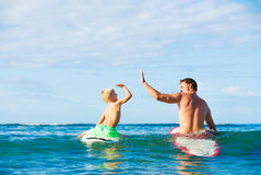 Father and Son Going Surfing Stock Photo