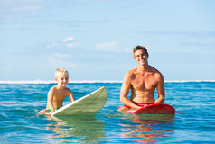 Father and Son Going Surfing Royalty Free Stock Photos