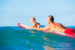Father and Son Going Surfing Royalty Free Stock Image