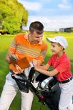 Father with son at golf Royalty Free Stock Photography