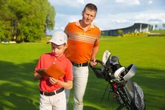 Father with son at golf Royalty Free Stock Photos