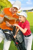 Father with son at golf Royalty Free Stock Photo