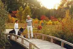 Father with son at golf field Royalty Free Stock Photography