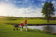Father with son at golf field Stock Images