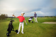 Father with son at golf Stock Photos