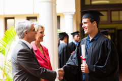 Father son graduation. Proud father congratulating his son on graduation day Royalty Free Stock Photos