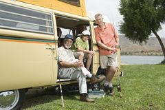 Father, Son And Grandson In Campervan Prepare To Go Fishing. Portrait of father, son and grandson in campervan prepare to go fishing Royalty Free Stock Image