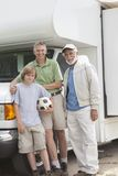 Father, Son And Grandson Stand By RV Home. Portrait of happy boy with father and grandfather standing in front of RV home Royalty Free Stock Photo