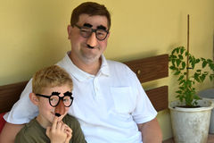 Father and son. With groucho marx glasses Royalty Free Stock Photos