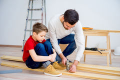 Father and son hammering nails Royalty Free Stock Photography