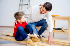 Father and son hammering nails Royalty Free Stock Images