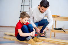 Father and son hammering nails Royalty Free Stock Photo