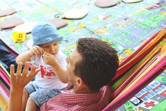 Father son hammock talking outside playground royalty free stock photos