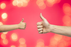 Father and son hands giving like Royalty Free Stock Image