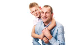 Father and son. Happy father and son in blue and white shirt on a white background. Son hugging father stock image