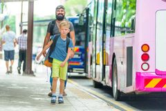 Father and son happy and excited together for the trip to Kuala. Lumpur. Making a city tour. Holiday vacation, traveling abroad concept, copy space Stock Image