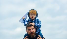 Father and son. Happy family father and child on meadow with a kite in the summer on the nature. Enjoy. Happy kid royalty free stock image