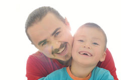 Father and son happy smiling in sun rays. Isolated on white stock photo