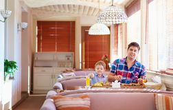 Father and son have a dinner in restaurant Royalty Free Stock Photos