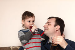 Father with son have drinks Stock Photos