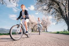 Father and son have a fun active leisure together - ride bicycle Stock Image