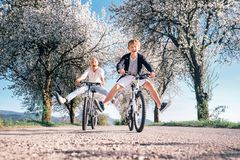 Father and son have a fun when riding bicycles on country road w Royalty Free Stock Photography