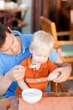 Father and son having breakfast stock photos