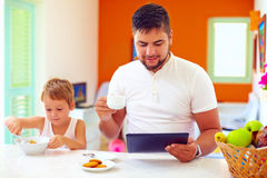 Father and son having breakfast in the morning at home kitchen Stock Photography