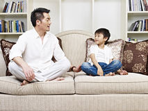 Father and son. Having a conversation on couch at home Royalty Free Stock Photos