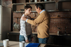 Father and son having friendly talk Royalty Free Stock Image
