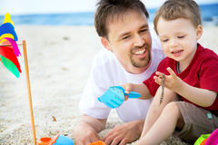 Father and son having fun on the beach. Royalty Free Stock Image