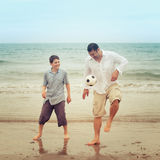 Father and son having fun on the beach Stock Image