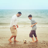 Father and son having fun on the beach Royalty Free Stock Photo